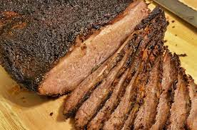 Should dogs eat raw or smoked brisket meat